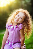 Happy little girl in sunset light. Royalty Free Stock Photos