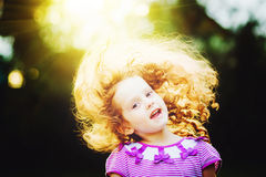 Happy little girl in sunset light. Royalty Free Stock Photo