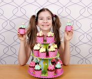 Little girl with sweet muffins Stock Images