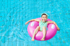 Happy little girl in the swimming pool Royalty Free Stock Images