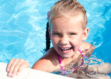 Happy little girl in swimming pool Royalty Free Stock Photography