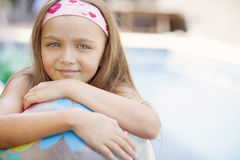 Happy little girl in swimming pool royalty free stock photos