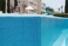 Little girl swimming in a pool. Happy little girl swimming in a pool Stock Image