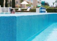 Little girl swimming in a pool. Happy little girl swimming in a pool Stock Images