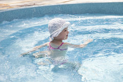 Happy little girl in swimming pool Royalty Free Stock Photo