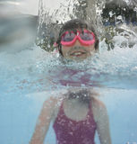 Happy little girl swimming in a pool Royalty Free Stock Photo