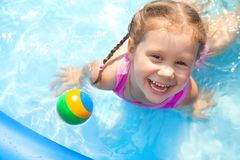 Happy little girl  Swimming Stock Image