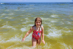 Happy little girl swimming in water Royalty Free Stock Photos