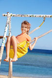 Happy little girl on  swing. Royalty Free Stock Photography