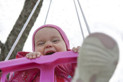 Happy little girl in a swing Stock Photography
