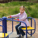 Happy little girl on a swing.  Royalty Free Stock Photo