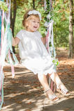 Happy little girl on a swing. Child, Playing, Playground. Happy little girl on a swing royalty free stock image