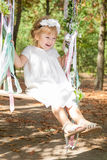 Happy little girl on a swing. Child, Playing, Playground. Happy little girl on a swing stock images
