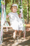 Happy little girl on a swing. Child, Playing, Playground. Happy little girl on a swing stock image