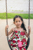 Happy Little Girl on Swing. Smiling face stock photos