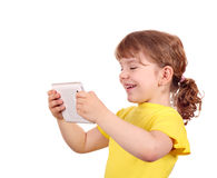 Happy little girl with tablet pc Royalty Free Stock Photography