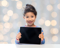 Happy little girl with tablet pc computer Royalty Free Stock Photography
