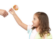 Happy little girl taking candy from her mother Royalty Free Stock Photo