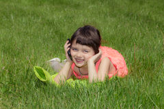 Happy little girl talking on the cellphone Royalty Free Stock Images
