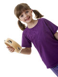Happy little girl with a tamburine Stock Photo