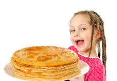 Happy little girl with tasty pancakes Royalty Free Stock Photo