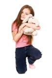 Happy little girl with a teddy elephant Royalty Free Stock Photos