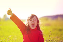 Happy little girl with thumb Stock Photos