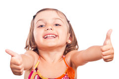 Happy little girl thumbs up Stock Photos