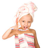 Happy little girl with toothbrush Stock Images