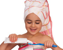 Happy little girl with toothbrush Royalty Free Stock Images