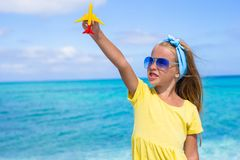 Happy little girl with toy airplane in hands on Stock Photography