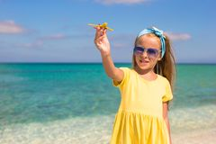 Happy little girl with toy airplane in hands on Royalty Free Stock Photography