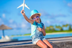 Happy little girl with toy airplane in hands on Stock Image