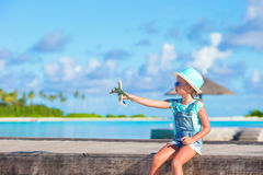 Happy little girl with toy airplane in hands on Royalty Free Stock Photos