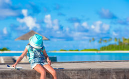 Happy little girl with toy airplane in hands on Royalty Free Stock Image