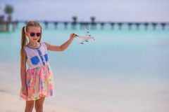 Happy little girl with toy airplane in hands on Royalty Free Stock Images