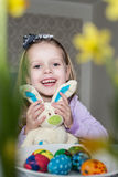 Happy little girl with toy bunny and easter eggs Royalty Free Stock Photography