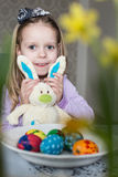 Happy little girl with toy bunny and easter eggs Stock Photography