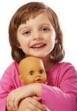 Happy little girl with toy doll Royalty Free Stock Photography