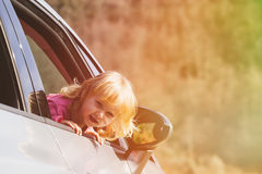 Happy little girl travel by car Stock Image