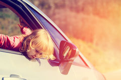 Happy little girl travel by car Stock Images
