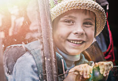 Happy little girl travel by car in spring nature. Stock Photo