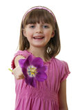 Happy little girl with a tulip flower Royalty Free Stock Image