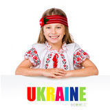 Happy little girl in the Ukrainian national costume Royalty Free Stock Photo