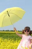 Happy little girl with umbrella Stock Photography