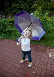 Happy little girl with umbrella Royalty Free Stock Photo