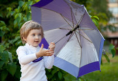 Happy little girl with umbrella Royalty Free Stock Photos