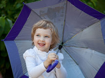 Happy little girl with umbrella Stock Photo