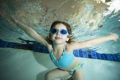Happy Little Girl Underwater In Pool Stock Images
