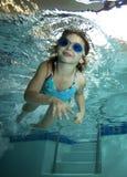 Happy Little Girl Underwater In Pool Stock Image